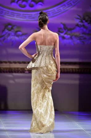 NEW YORK - FEBRUARY 16:  A Model walks on the Amal Sarieddine fashion runway at The New Yorker Hotel during Couture Fashion Week on February 16, 2013 in New York City