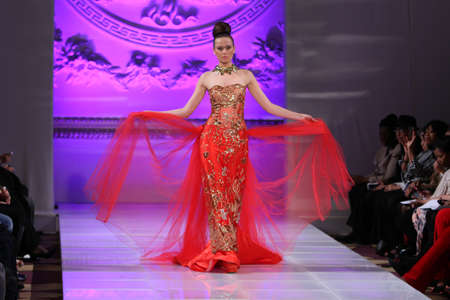 NEW YORK - FEBRUARY 17:  A Model walks on the Lourdes Atencio fashion runway at The New Yorker Hotel during Couture Fashion Week on February 17, 2013 in New York City