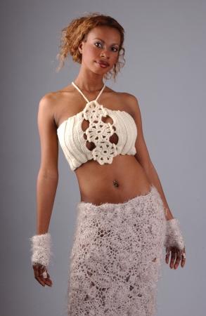 Beautiful African American model posing wearing fashionable dresses