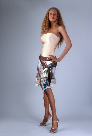 Beautiful African American model posing wearing fashionable dresses photo