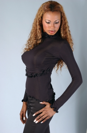 Beautiful African American model posing wearing fashionable dresses photo