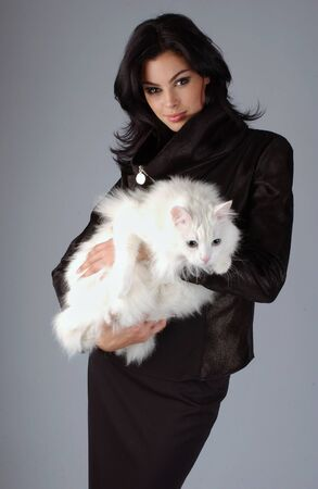 Portrait of sophisticated brunette woman with white Cat photo