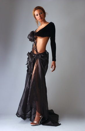 Beautiful African American model posing wearing fashionable dresses