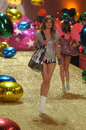 hi resolution: NEW YORK - NOVEMBER 10: Victorias Secret Fashion Show model walks the runway during the 2010 Victorias Secret Fashion Show on November 10, 2010 at the Lexington Armory in New York City.