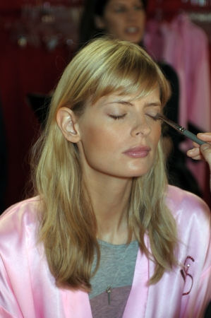 NEW YORK - NOVEMBER 10: Victorias Secret model  Julia Stegner getting ready backstage  during the 2010 Victorias Secret Fashion Show on November 10, 2010 at the Lexington Armory in New York City.