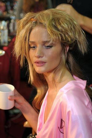NEW YORK - NOVEMBER 10: Victorias Secret model  Rosie Huntington-Whiteley getting ready backstage  during the 2010 Victorias Secret Fashion Show on November 10, 2010 at the Lexington Armory in New York.