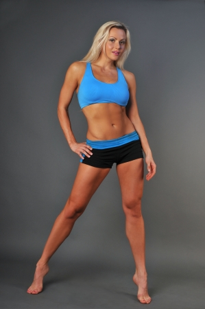 A sporty fit woman in her fitness clothes  Stock Photo - 18477780