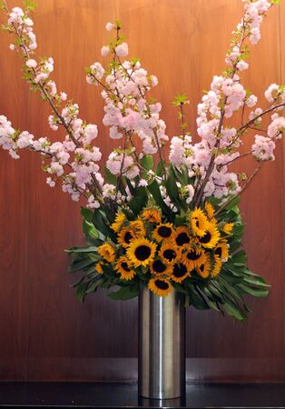 Composition of chery blossom and sunflowers photo