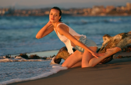 Fashion Model posing sexy at ocean golden sunset in Palos Verdes, Southern California, USA photo