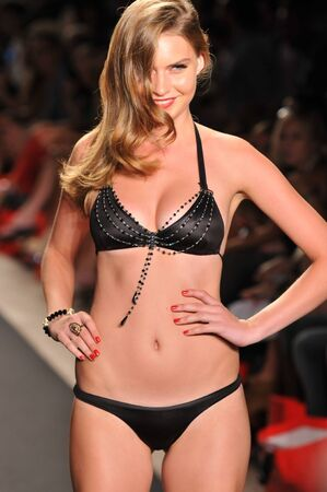 MIAMI - July 14: Model walks runway at the Beach Bunny Swimsuit Collection for Spring Summer 2012 during Mercedes-Benz Swim Fashion Week on July 14, 2011 in Miami, FL