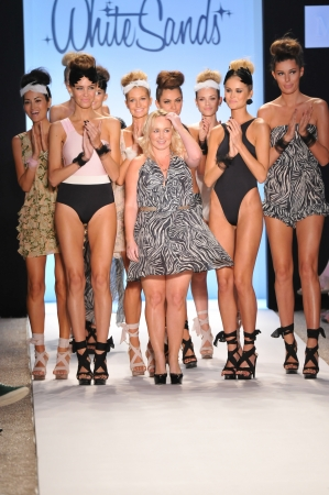 leah: MIAMI - JULY 15: Designer Leah Madden (C) and models walks runway at the White Sands Australia Swimsuit Collection for Spring Summer 2012 during Mercedes-Benz Swim Fashion Week on July 15, 2011 in Miami, FL Editorial