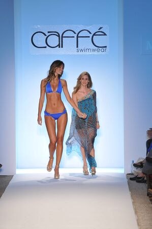MIAMI - JULY 16: Designer Paula Saavedra (R) walks with a model runway at the Caffe Swimwear Collection for Spring Summer 2012 during Mercedes-Benz Swim Fashion Week on July 16, 2011 in Miami, FL  Editöryel