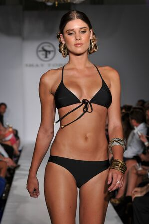 MIAMI - JULY 16: Model walks runway at the Shay Todd Swimsuit Collection for Spring/ Summer 2012 during Mercedes-Benz Swim Fashion Week on July 16, 2011 in Miami, FL Stock Photo - 18536540