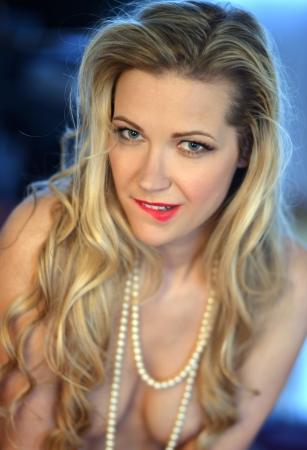 Portrait of beautiful blond girl wearing lingerie