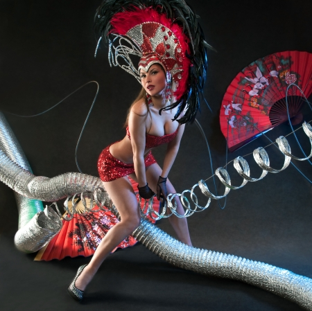 Las Vegas Dancer posing at futuristic background on club stage