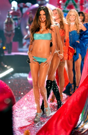 NEW YORK - NOVEMBER 9: Victorias Secret Fashion models walks the runway finale during the 2010 Victorias Secret Fashion Show on November 9, 2005 at the Lexington Armory in New York City.  Editorial