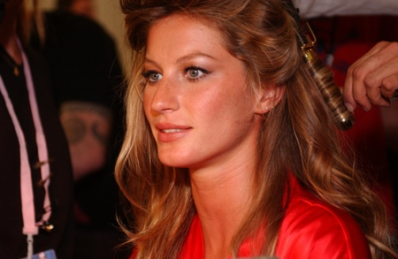 anja: NEW YORK - NOVEMBER 9: Victorias Secret Fashion model Gisele Bündchen getting ready backstage during the 2010 Victorias Secret Fashion Show on November 9, 2005 at the Lexington Armory in New York City.  Editorial