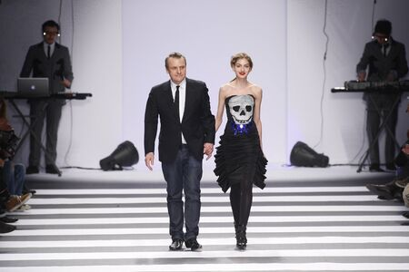 PARIS, FRANCE - MARCH 08: Designer Jean-Charles de Castelbajac and model walks the runway during the Jean-Charles de Castelbajac Ready to Wear Autumn/Winter 2011/2012 show during Paris Fashion Week at Pavillon Concorde on March 8, 2011 in Paris, France.