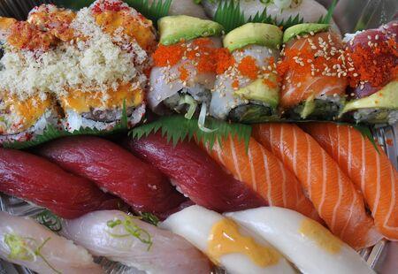 Sushi, sashimi, rolls on tray closeup - traditional japanese food