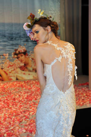 NEW YORK- OCTOBER 14: Model poses on runway for Claire Pettibone bridal show for Fall 2013 during NY Bridal Fashion Week on October 14, 2012 in New York City, NY