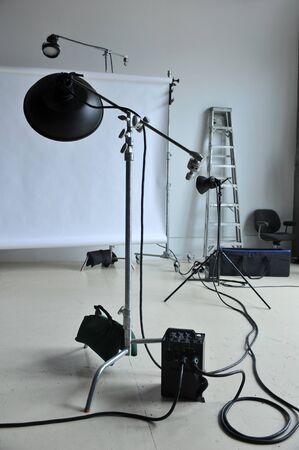 photo studio: Empty photo studio with lighting equipment  Stock Photo