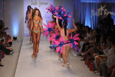 MIAMI - JULY 17: Brazilian dancers performs on runway at the Luli Fama Collection for Spring/ Summer 2012 during Mercedes-Benz Swim Fashion Week on July 17, 2011 in Miami, FL Stock Photo - 19183920