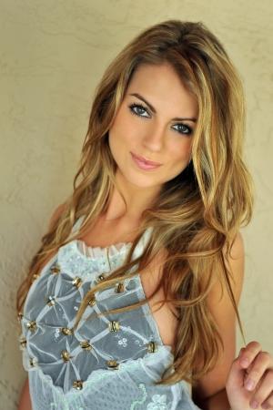 Glamor blond girl posing pretty outside wearing designers lingerie and custom jewelery Stock Photo