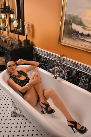 Portrait of sophisticated brunette woman in the bath tub Stock Photo - 19674912