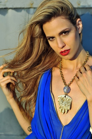 Closeup portrair of fashion model with full hair and red lips,  posing sexy and wearing long blue evening dress and fashion acessories Stock Photo - 20454234