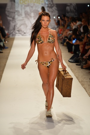 MIAMI - JULY 19: Model walks runway at the Agua Bendita Collection for Spring Summer 2014 during Mercedes-Benz Swim Fashion Week on July 19, 2013 in Miami, FL