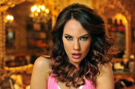 Warm light beauty shoot of brunette model in Beauty salon interior photo