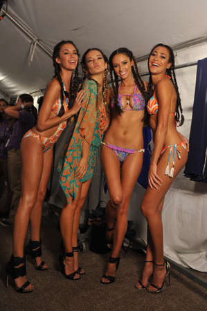 MIAMI - JULY 20: Models getting ready for the show at the Agua Di Lara 2014 Collection backstage during Mercedes-Benz Swim Fashion Week on July 20, 2013 in Miami South Beach, FL