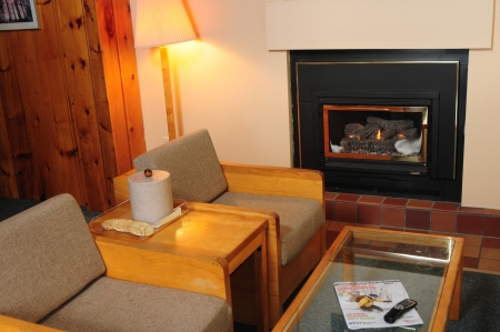 timeshare: Vacation house living room with a fireplace
