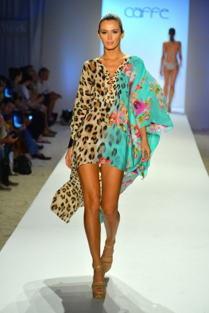 MIAMI BEACH, FL - JULY 21: A model walks the runway at the Caffe Swimwear show during Mercedes-Benz Fashion Week Swim 2014 at the Raleigh on July 21, 2013 in Miami Beach, Florida 新聞圖片