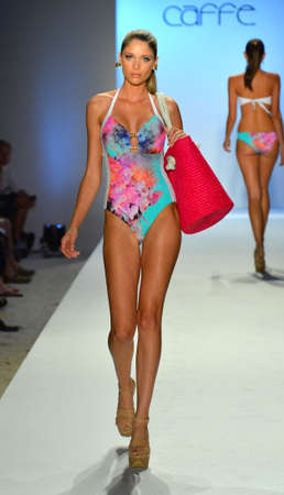 MIAMI BEACH, FL - JULY 21: A model walks the runway at the Caffe Swimwear show during Mercedes-Benz Fashion Week Swim 2014 at the Raleigh on July 21, 2013 in Miami Beach, Florida