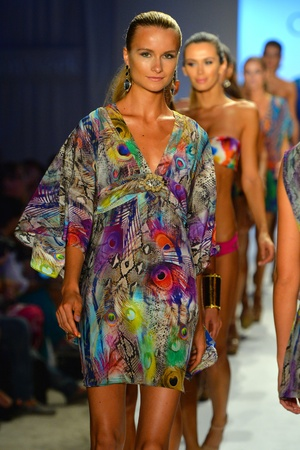 MIAMI, FL - JULY 21: Models walk the runway finale at the Caffe Swimwear show during Mercedes-Benz Fashion Week Swim 2014 at Oasis at the Raleigh on July 21, 2013 in Miami, Florida.