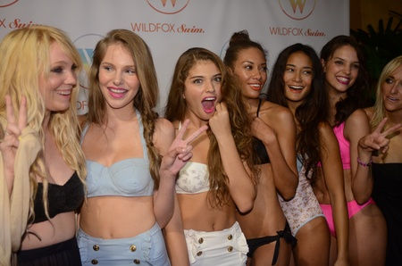 penthouse: MIAMI - JULY 15: Wildfox designers Emily Faulstich and Kimberly Gordon and models at the Wildfox Swim 2012 presentation at penthouse of Raleigh hotel during Mercedes-Benz Swim Fashion Week on July 15, 2011 in Miami, FL  Editorial