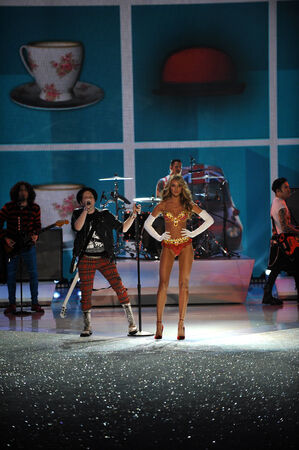 NEW YORK, NY - NOVEMBER 13: Musicians Joe Trohman, Patrick Stump, Andy Hurley, and Pete Wentz of the band Fall Out Boy perform and model Candice Swanepoel walks in the 2013 Victorias Secret Fashion Show  on November 13, 2013 in New York City.