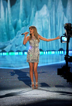 performs: NEW YORK, NY - NOVEMBER 13: Singer Taylor Swift performs at the 2013 Victorias Secret Fashion Show at Lexington Avenue Armory on November 13, 2013 in New York City. Editorial