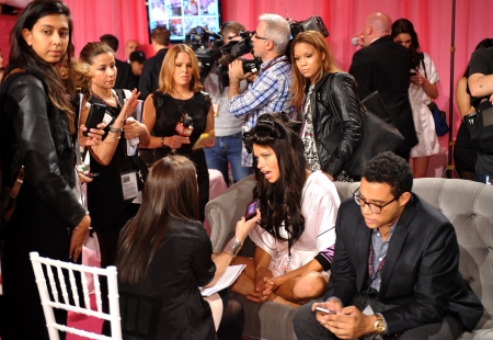NEW YORK, NY - NOVEMBER 13: Adriana Lima giving away interviews backstage at the 2013 Victorias Secret Fashion Show at Lexington Avenue Armory on November 13, 2013 in New York City.
