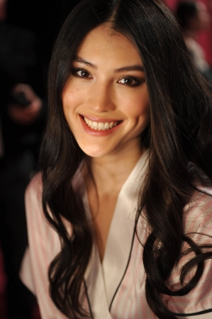 he: NEW YORK, NY - NOVEMBER 13: Model Sui He prepares at the 2013 Victorias Secret Fashion Show hair and make-up room at Lexington Avenue Armory on November 13, 2013 in New York City.