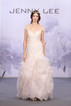 NEW YORK, NY - OCTOBER 12: A model walks the runway at the Jenny Lee 2014 Bridal collection show at hotel Waldorf Astoria on October 12, 2013 in New York City.