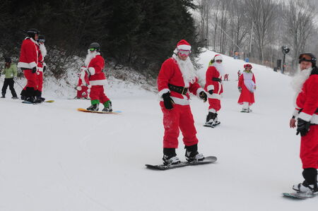 WINDHAM DECEMBER 19 - Skiing and Riding Santas for charity at Windham Mountain. Windham Mountain, Windham NY December 19, 2010