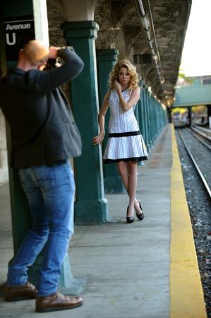 subway platform: Photographer shooting model at NYC Subway platform Stock Photo