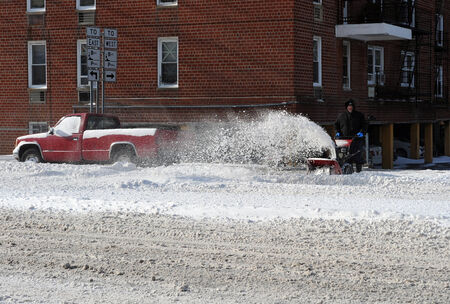 Cleaning streets in Brooklyn after the seasons first snow storm