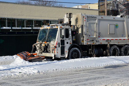 Sanitation tracks cleaning streets in Brooklyn is seen after the seasons first snow storm in NYC