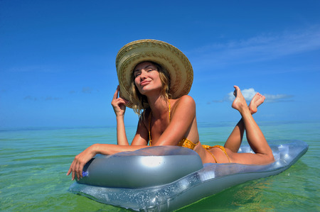 Sexy girl resting at mattress at tropical water 新聞圖片