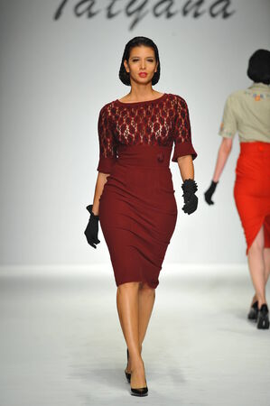 eveningwear: LOS ANGELES, CA - MARCH 09: A model walks the runway at Tatyana Designs - Bettie Page collection during Style Fashion Week Fall 2014 on March 09, 2014 in Los Angeles