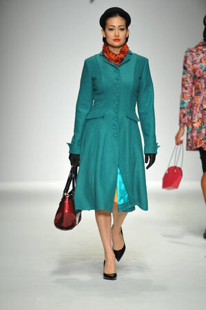 woman s bag: LOS ANGELES, CA - MARCH 09: A model walks the runway at Tatyana Designs - Bettie Page collection during Style Fashion Week Fall 2014 on March 09, 2014 in Los Angeles