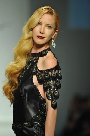 eveningwear: LOS ANGELES, CA - MARCH 10: A model walks runway at Andre Soriano fashion show during Style Fashion Week Fall 2014 at The Live Arena on March 10, 2014 in Los Angeles.